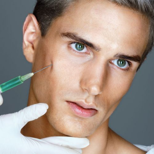 67272556 - attractive man getting lifting  injection in cheekbones. injections of skin rejuvenation. cosmetic procedures