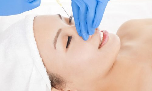 26963304 - woman is doing cosmetic surgery injections