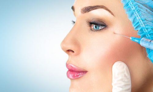 50989051 - beauty woman gets facial injections. cosmetology