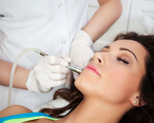 26245270 - woman getting laser face treatment in medical spa center, skin rejuvenation concept