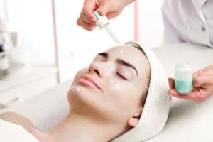 35864583 - serum facial treatment of young woman in spa salon